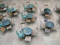 Terrasse. Empty cafe terrasse with metallic tables and metallic-wooden chairs stock photography