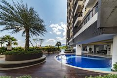 Terrasse and garden of Malaysian condominium. Building in Kuala Lumpur under a beautiful blue sky royalty free stock photography