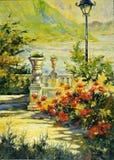 Terrasse mit Blumen und einer Laterne Lizenzfreies Stockfoto