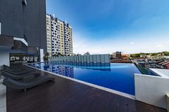 Terrasse and swimming pool of Malaysian condominium. Building in Kuala Lumpur under a beautiful blue sky stock photos