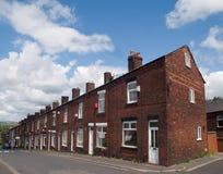 Terrasserade hus på en Lancashire stadkulle Arkivfoton