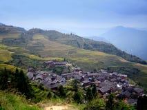 Terrazzi del riso e villaggio - Cina Immagine Stock Libera da Diritti
