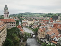 The Terre. Panoeamic view of Cesky Krumlov with plenty of terra cotta roofing buildings along the river with the mountain as background Royalty Free Stock Images