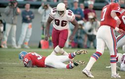 Terrell Davis hits the turf. Denver Broncos RB Terrell Davis hits the turf before meeting up with Clyde Simmons #96 of the Arizona Cardinals.  Image came from Stock Images