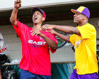 Terrell Osborne and Chris Tucker. Terrell Osborne and comedian Chris Tucker share a laugh before the start of a Charity Softball Game in Pawtucket, Rhode Island Royalty Free Stock Images