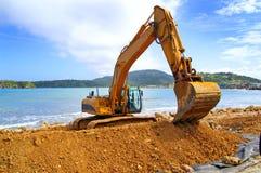 Terreno commovente dell'escavatore a cucchiaia rovescia Fotografia Stock Libera da Diritti