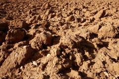 Terreno strutturato di agricoltura rossa dell'argilla Fotografia Stock Libera da Diritti