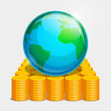 Terrestrial globe and gold coins. Terrestrial globe is lying on gold coins. Money as basis of stability in the world Royalty Free Stock Image
