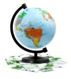 Terrestrial globe, money Stock Photo