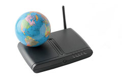 Terrestrial globe over a black router isolated on white backgrou Stock Images