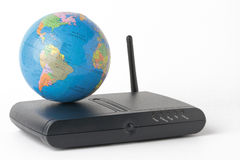 Terrestrial globe over a black router isolated on white backgrou Stock Photography