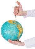 Terrestrial globe and syringe Stock Images