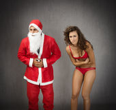 Terrible ache for santa claus and girl Stock Photography