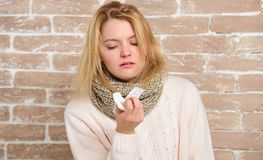 Terrible allergy. Cute woman caught nasal cold or allergic rhinitis. Sick woman blowing her nose in napkin. Pretty girl stock image