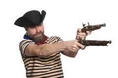 Terrible bearded pirate in tricorn hat. With a muskets Royalty Free Stock Images