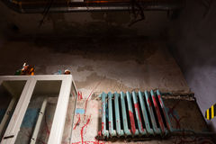 Terrible bloodied battery near glass case in dimly lit basement Stock Image