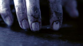 Terrible burnt hand is chained to an iron chain. monster hand on Halloween stock footage