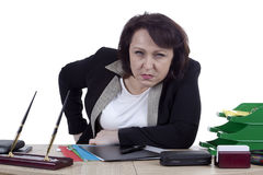 Terrible business woman at work desk Royalty Free Stock Image