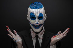 Free Terrible Clown And Halloween Theme: Crazy Blue Clown In Black Suit Isolated On A Dark Background In The Studio Royalty Free Stock Image - 56339936