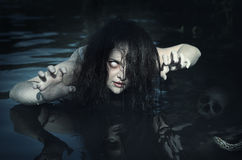 Terrible dead ghost woman in the water. Outdoor stock photos