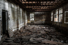 Terrible destroyed room. The window is chock-full of boards. Abandoned building Stock Photos