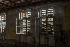 Terrible destroyed room. The window is chock-full of boards. Abandoned building Royalty Free Stock Image