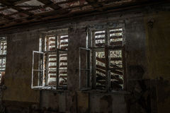 Terrible destroyed room. The window is chock-full of boards. Abandoned building royalty free stock photo