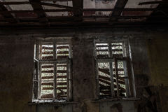 Terrible destroyed room. The window is chock-full of boards. Abandoned building royalty free stock photography