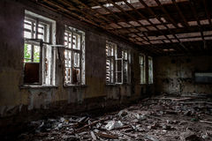 Terrible destroyed room. The window is chock-full of boards. Abandoned building Stock Image