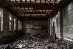 Terrible destroyed room. The window is chock-full of boards. Abandoned building stock photography