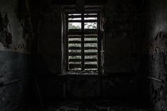 Terrible destroyed room. The window is chock-full of boards. Abandoned building Stock Images