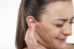 Terrible ear pain. On white background Royalty Free Stock Photo