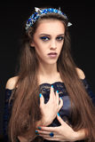 Terrible girl with a long face in the diadem.  Royalty Free Stock Image