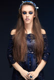 Terrible girl with a long face in the diadem Stock Photography