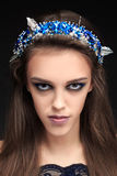 Terrible girl with a long face in the diadem Royalty Free Stock Photos