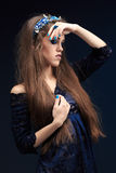 Terrible girl with a long face in the diadem Stock Images