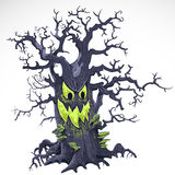 Terrible Halloween cartoon tree with a grin Royalty Free Stock Photo