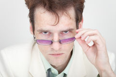 Terrible man strictly looks at us over spectacles Royalty Free Stock Images