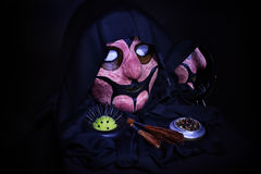 Terrible mask , objects of black magic and witchcraft. On a black background Royalty Free Stock Images
