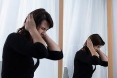 Terrible migraine Stock Image