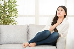Terrible pain in her throat Royalty Free Stock Photography