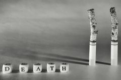 A terrible picture about death due to smoking. Agitation for a healthy lifestyle. Black and white, toning stock image