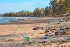 Terrible pollution of the ocean shore. Stock Photos
