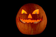 Terrible pumpkin. Photo of terrible pumpkin with grin on a black background Stock Photo