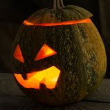 A terrible pumpkin on the holiday of Halloween on the old tree table. With a place for the inscription Royalty Free Stock Photography