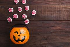 Terrible sweets brains for Halloween in decorative pumpkin on Stock Image