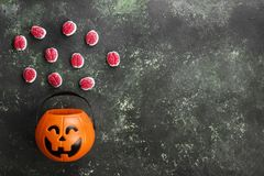 Terrible sweets brains for Halloween in decorative pumpkin on Royalty Free Stock Photo