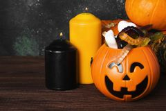 Terrible sweets for Halloween in decorative pumpkin on a dark ba Royalty Free Stock Image