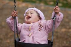 Terrible twos temper tantrum. Adorable little girl throwing a huge temper tantrum on the swing set stock photos
