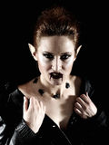 Terrible vampire woman with spiders and blood Royalty Free Stock Image